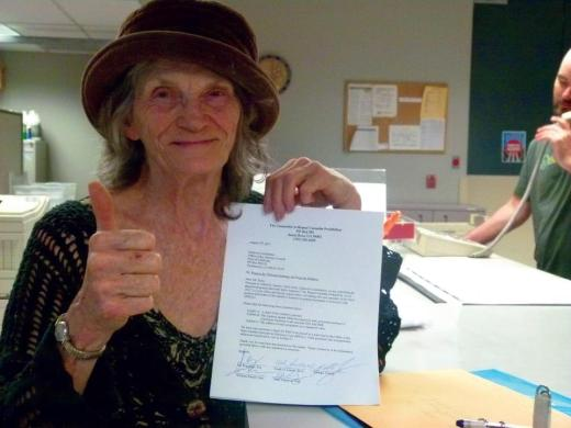 Pebbles Trippet turns in the text of Repeal Cannabis Prohibition Act 2012 to the California Attorney General.